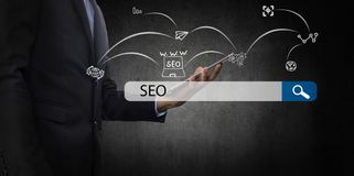 Searching Engine Optimizing SEO Browsing Concept, Businessman ho. Lding phone for looking information with technology and internet icon Royalty Free Stock Photo