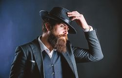 Searching for fashion muse. Businessman in suit. brutal caucasian hipster with moustache. Detective in hat. Mature royalty free stock images