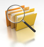 Searching Files. Magnifying Glass looking a a group of computer data folders, searching for a file(s Royalty Free Stock Images