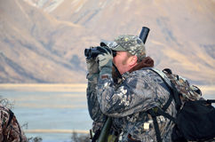Searching for game. Camoflaged hunter searching for Himalayan tahr in the Southern Alps of New Zealand Stock Photos