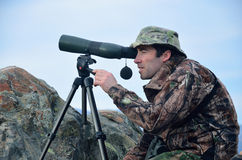 Searching for game. Camoflaged hunter searching for Himalayan tahr in the Southern Alps of New Zealand Royalty Free Stock Image