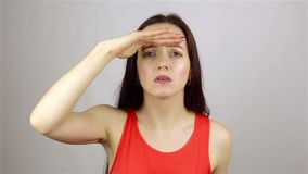 Searching Gesture by Beautiful Young Woman stock video footage
