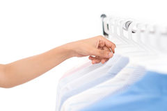 Searching through hangers Royalty Free Stock Photo