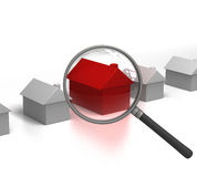 Searching Hot Property with Magnifying Glass. 3D render of a Magnifying glass examining a Red house amongst a row of grey ones Royalty Free Stock Photo