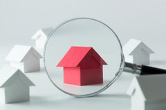 Searching for house. House searching concept with a magnifying glass royalty free stock photo