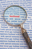 Searching for a husband. Text husband in red lowercase letters surrounded by related subjects in blue text and with a hand magnifier as a concept of searching Royalty Free Stock Photos