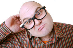Searching for an idea. Man with glasses and stupid expression Royalty Free Stock Photos