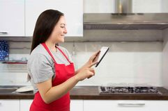 Searching the ideal recipe online Royalty Free Stock Photo