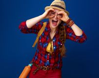 Smiling tourist woman looking through binocular shaped hands. Searching for inspiring places. smiling healthy tourist woman with backpack looking through Stock Photography