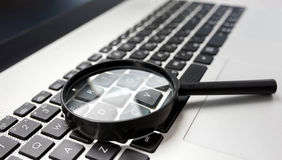 Searching On Internet Concept, Magnifier On Computer Keyboard Stock Photography