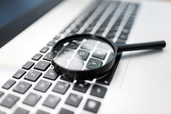 Searching On Internet Concept, Magnifier On Computer Keyboard Royalty Free Stock Images