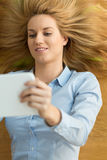 Searching the internet on a tablet Stock Photo