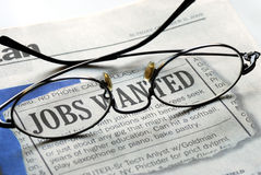 Searching for a job from a newspaper Stock Image