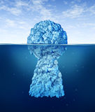 Searching For The Key To Success. With an iceberg shaped as a an icon of solutions security with the top in view and the rest hidden under arctic cold ocean as Stock Photo