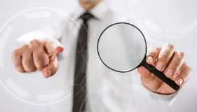 Searching For A Laborer Concept. With Magnifying Glass And  Finger Pointing Royalty Free Stock Photos