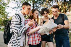 Searching the location on the city map. Traveling, sightseeing, group travel, city tour, student exchange program, togetherness and friendship. Searching the Royalty Free Stock Image