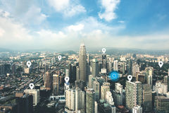 Searching location on map and pin above blue tone city scape and Stock Photography