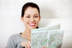 Searching in map. Stock Photography