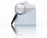 Searching through messages. PHOTOGRAPH (NOT illustration or 3D render) of opened envelope mail and message/letter with magnifying glass to symbolize searching Royalty Free Stock Photography