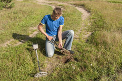 Searching with metal detector. Royalty Free Stock Photos