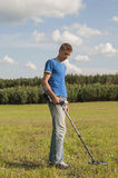 Searching with metal detector. Stock Photos