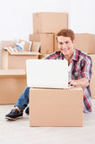 Searching a moving company in the net. Stock Images
