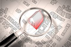 Searching new home concept image - Imaginary cadastral map of territory with buildings and roads through magnifying glass.  royalty free stock images