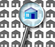 Searching for a new home. With a magnifying glass Stock Images