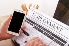 Searching for a new job or employment. In a newspaper royalty free stock images