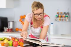 Searching for new recipe. Searching for a new recipe Stock Photos