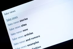 Searching online and checking fake news Stock Images