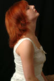 Searching For Peace. Side profile of red headed female at peace Stock Photos