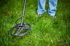 Searching for a precious metal. With a metal detector royalty free stock photography