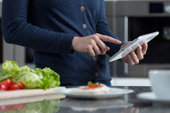 Searching for recipe on the tablet Royalty Free Stock Photography