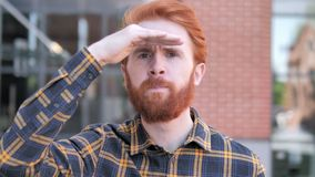 Searching Redhead Beard Young Man, Outdoor. 4k high quality, 4k high quality stock video footage