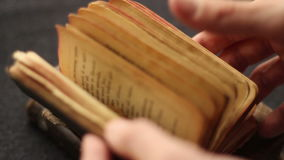 Searching in a religious book. stock video footage