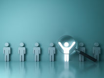 Searching for the right person concept, Stand out from the crowd and different concept. Magnifying glass focusing on the light man standing with arms wide Royalty Free Stock Images