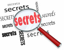 Searching for Secrets - Magnifying Glass Finds Clues. Secrets uncovered by a magnifying glass representing the search for clues in a mystery, with an royalty free illustration