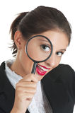 Searching for something. Woman in business dress looking through a magnifying glass. She is searching for something Royalty Free Stock Photography