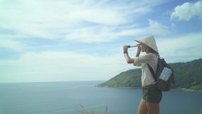 Searching for Summer Vacation. Tourist girl overlooking the ocean landscape, summer sea dream and imagination stock video footage