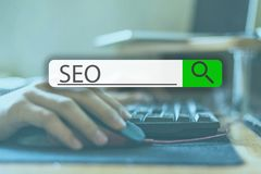 Searching tab on top of concept image with word SEO v stock image