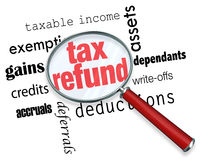Searching for a Tax Refund - Magnifying Glass. A magnifying glass hovering over several words, at the center of which is Tax Refund Royalty Free Stock Photo