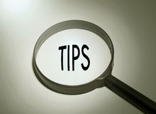 Searching tips. Magnifying glass with the word tips. Searching tips Stock Photography