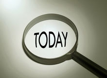 Searching today. Magnifying glass with the word today. Searching today Royalty Free Stock Photos