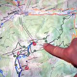 Searching for  travel in the Austrian alps. Searching for some travel in the Austrian alps with a map in the hands Stock Photos