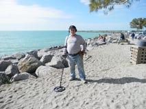 Searching for Treasure. A man searching for hidden treasure at Venice Beach Florida Stock Photos