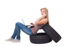 Searching for tyres and automotive parts. Royalty Free Stock Image