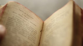 Searching in a vintage book stock footage