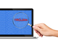 Searching Virus in Laptop Computer. Searching Trojan in Laptop Computer by Magnifying glass Royalty Free Stock Images