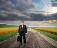 Searching work. Businessman searching work and walking in the countryside Royalty Free Stock Photography